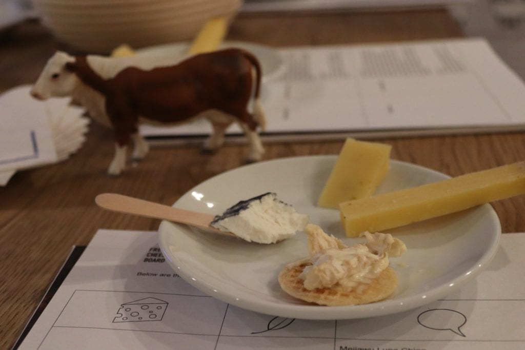Cheese on a plate with a cow figurine
