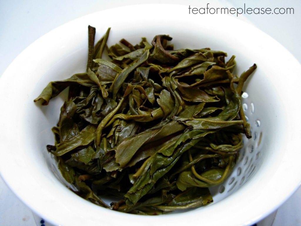 puerh leaves in white gaiwan