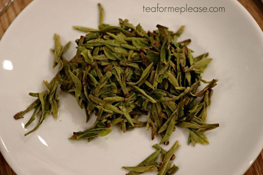 Wet green tea leaves