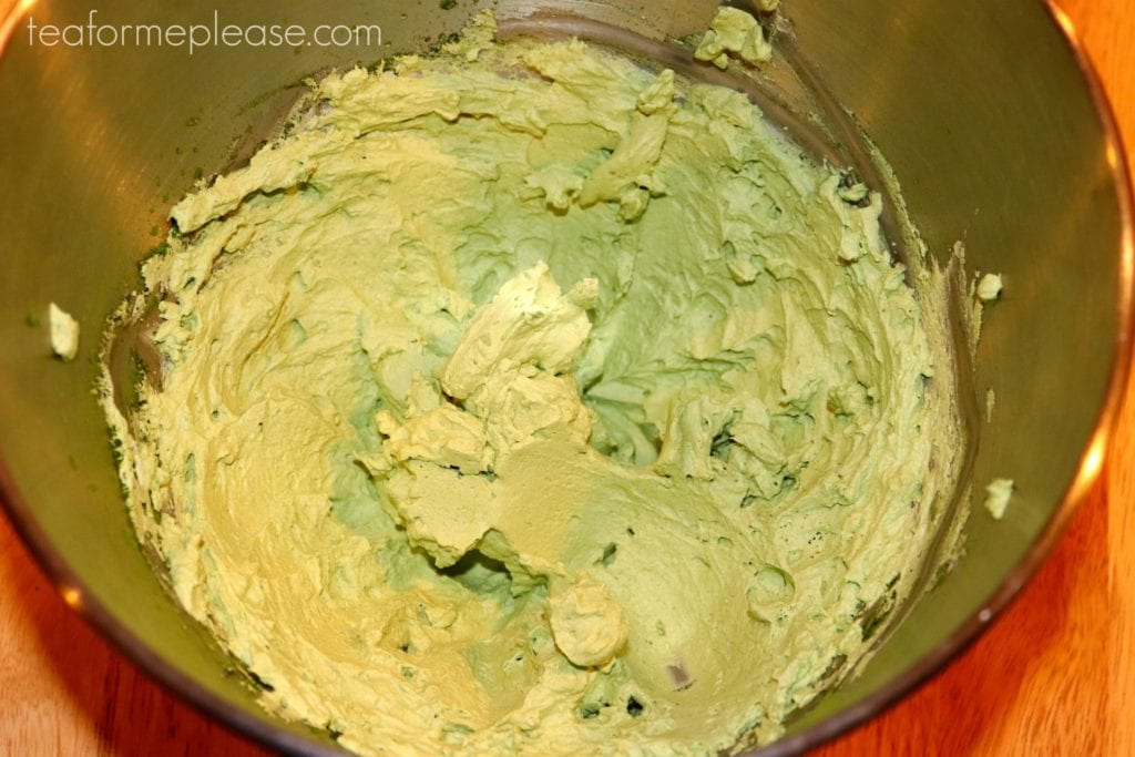 Matcha whipped cream in stainless steel bowl