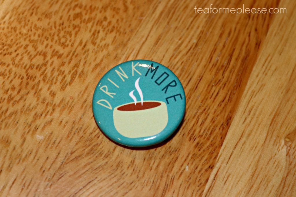 Blue pin that says drink more tea