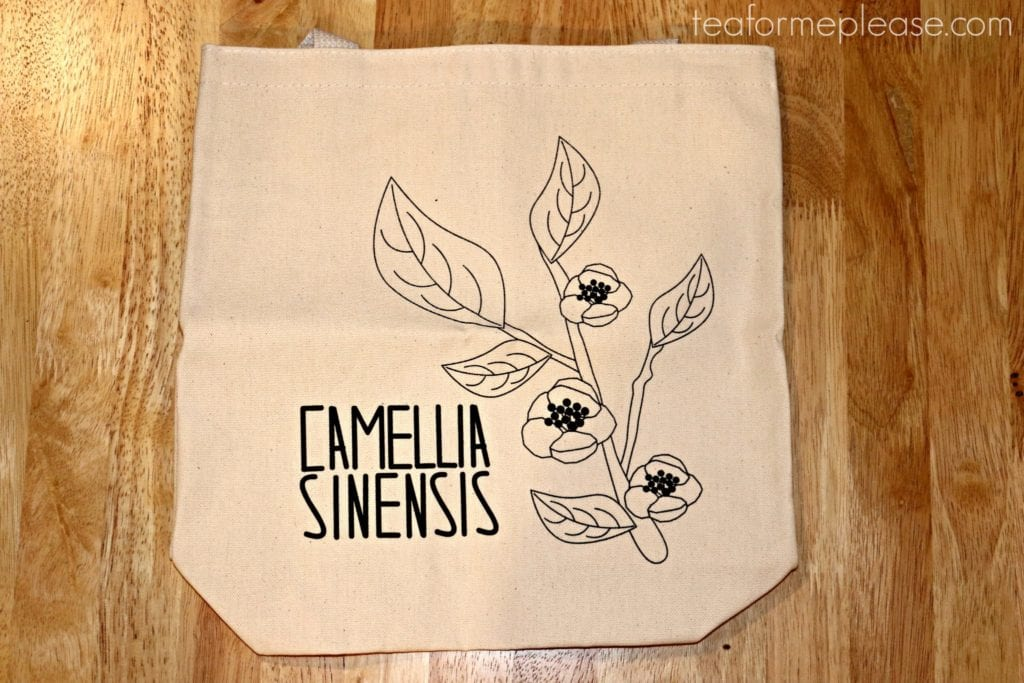 Canvas tote bag with a drawing of the Camellia Sinensis plant printed on it