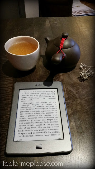 Kindle with teapot and cup of tea