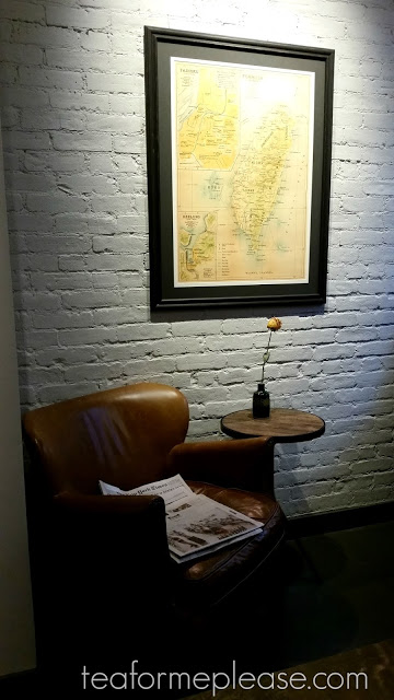 Leather chair with map of Taiwan on a white wall